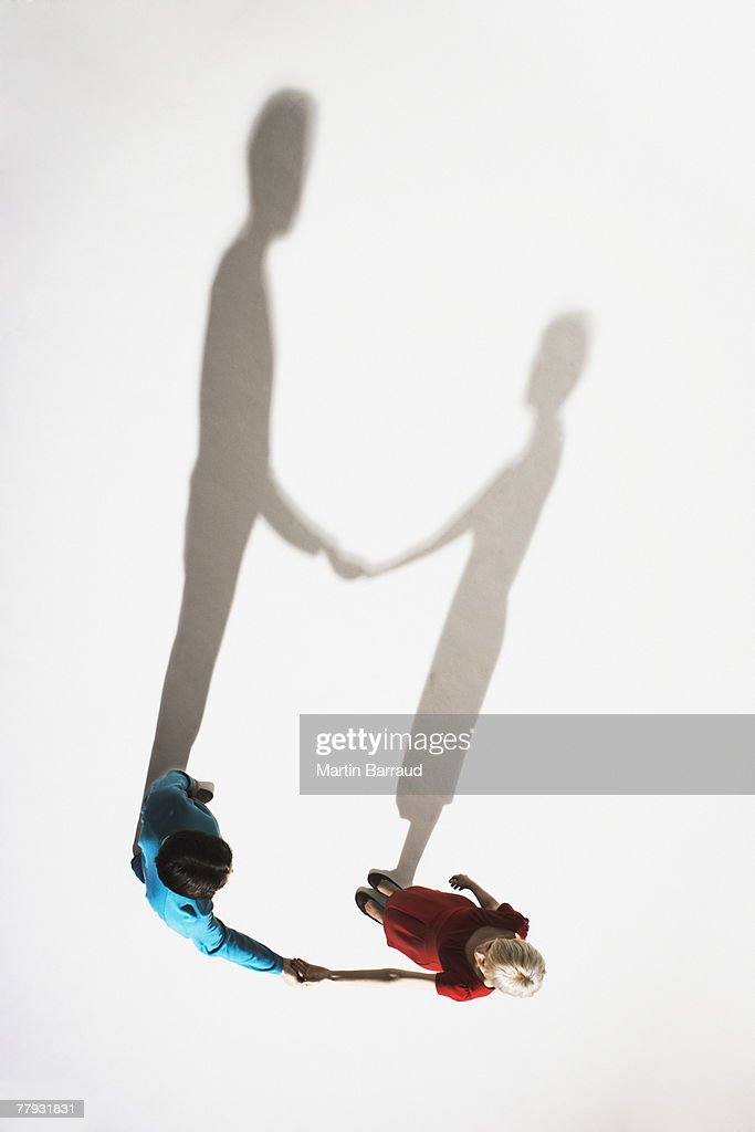 Couple holding hands from a high angle view