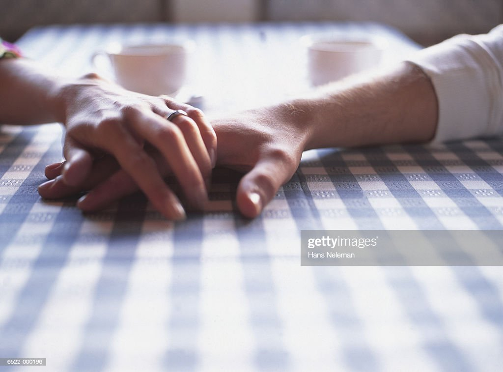 Couple Holding Hands in CafT