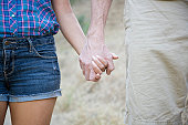 Couple holding hands in nature