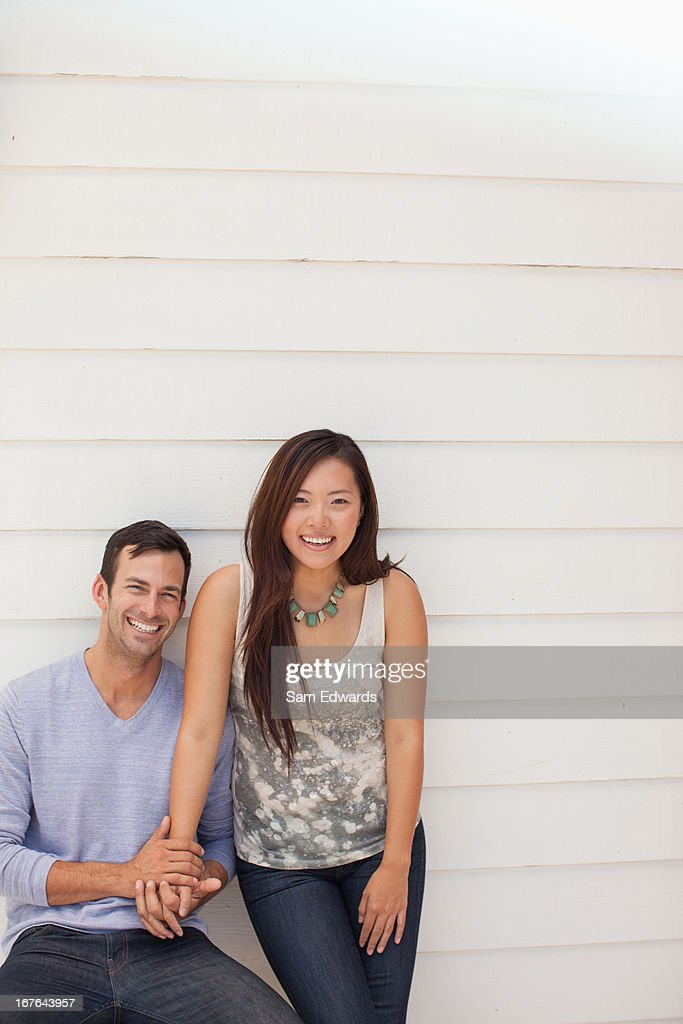 Couple holding hands outdoors : Stock Photo