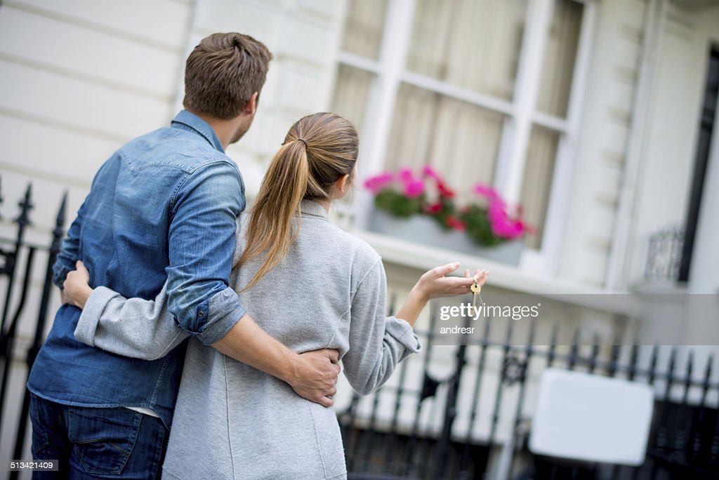 Couple holding house keys : Stock Photo