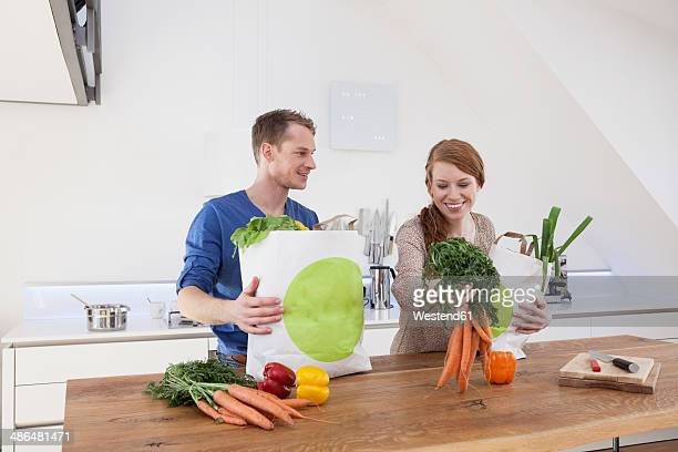 Couple holding shopping bags with purchases