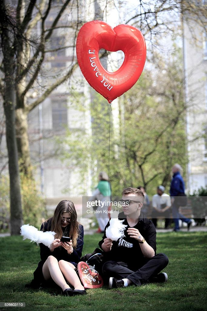 A couple holds a ballon at th annual Myfest in District Kreuzberg afternoon before several demonstrations on May, 2016 in Berlin, Germany. Tens of thousands of people across Germany participated in marches and gatherings by labor unions and in some cities left-wing and anarchist activists took to the streets under heavy oversight by police. In Berlin far-right protesters also attempted to hold rallies during the day.