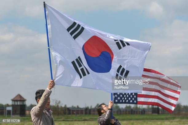 A couple holds South Korean and American flags during the annual March of the Living Jewish people from Israel and around the world marched the 3km...
