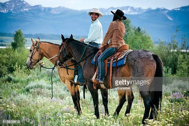 Couple horse riding, Montana