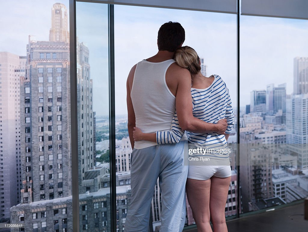 Couple hugging and looking outside