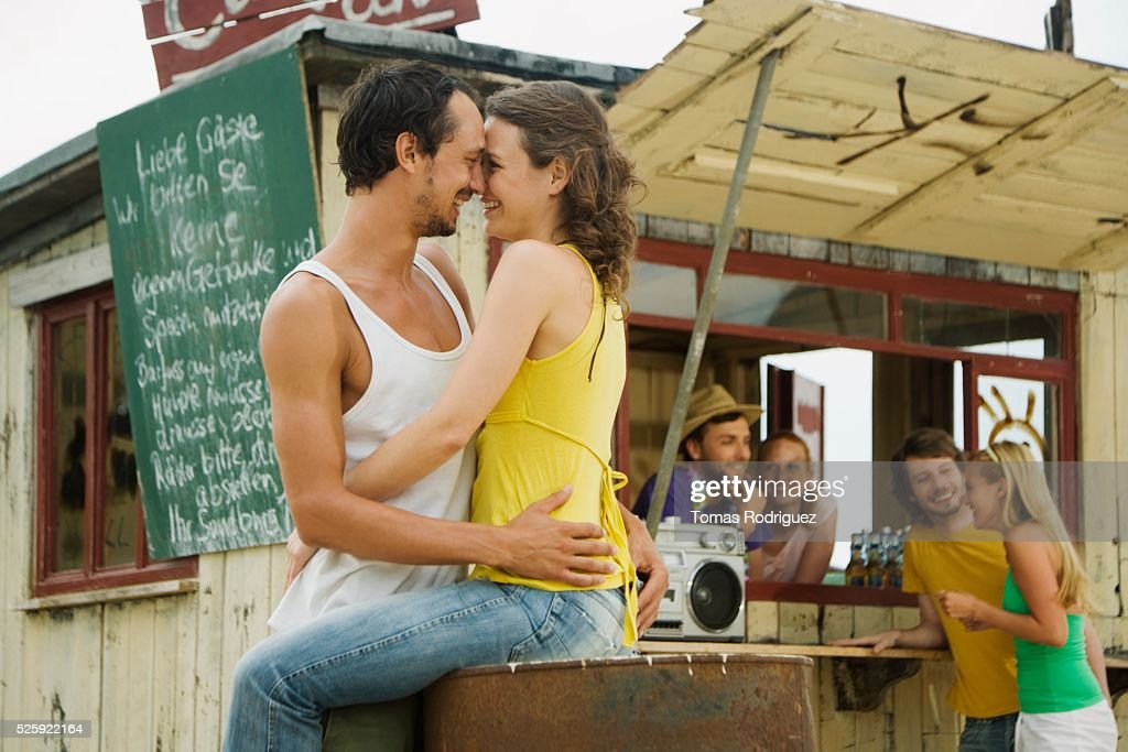 Couple Hugging at a Beach Bar : Foto de stock