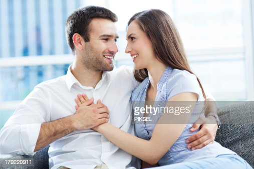 Couple hugging at home : Stock Photo