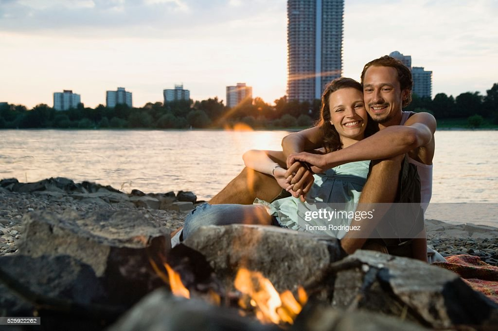 Couple Hugging by a Campfire : Stock Photo