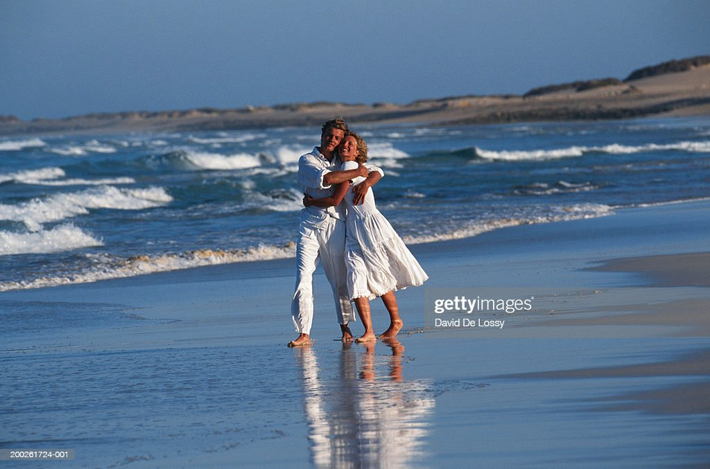 Couple hugging each other on beach : Stock Photo