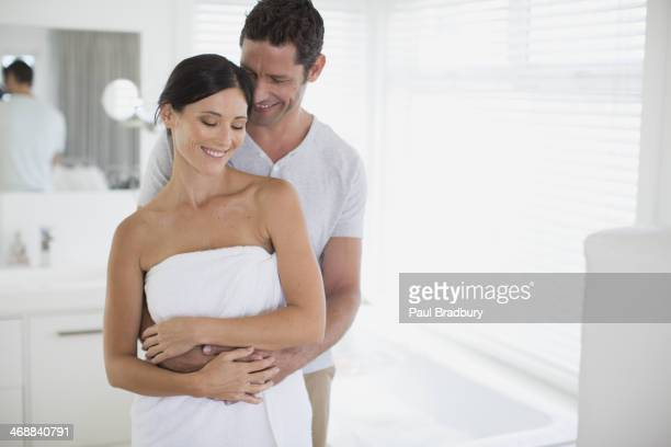 Couple hugging in bathroom