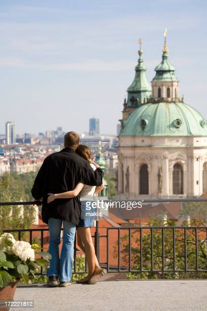 Couple hugging in front of a domed structure