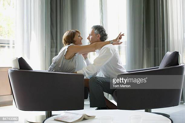 Couple hugging in modern hotel suite