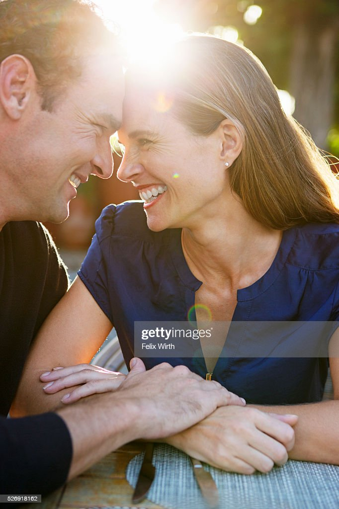 Couple hugging in outdoor restaurant : Stock Photo