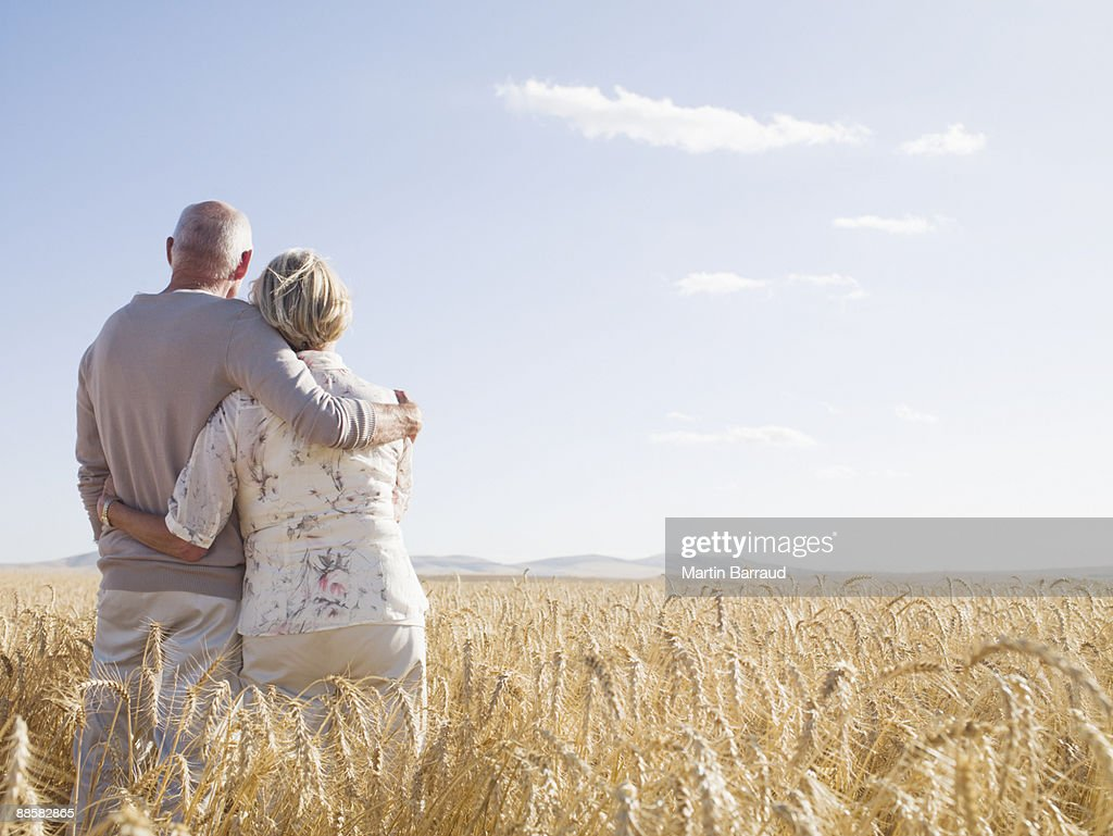 Couple hugging in remote wheat field : Stock Photo