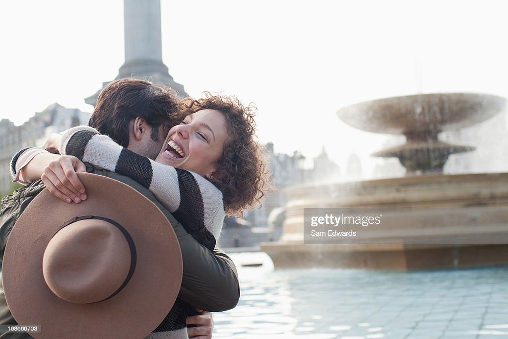 Couple hugging near fountain : Stock Photo
