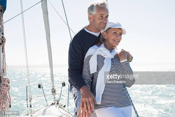 Couple hugging on deck of boat