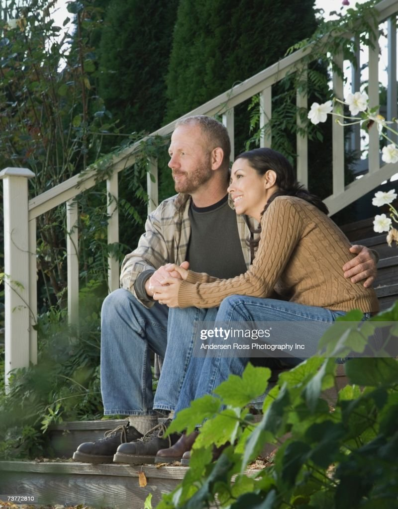 Couple hugging on porch steps : Stock Photo