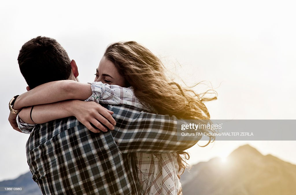 Couple hugging outdoors : Stock Photo
