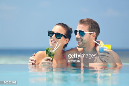 couple hugging pool cocktails   Stock Photo. Couple Hugging Pool Cocktails Stock Photo   Getty Images
