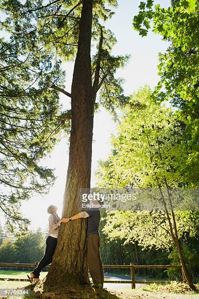 Couple hugging tree