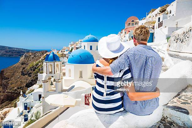 Couple hugs overlooking Santorini Island, Greece