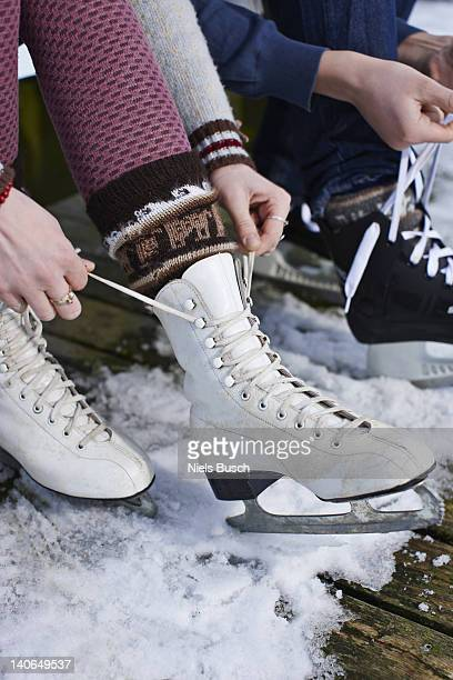 Couple ice skating on lake