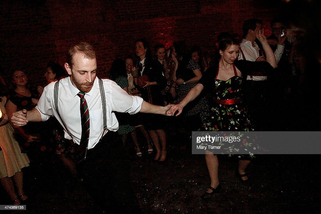 A couple in 1940s costumes dance to swing band 'The Red Roosters' during The Blitz Party on February 22, 2014 in London, England. Deep in an East End bunker hundreds of vintage enthusiasts partied like it was 1940 in a range of wartime costumes. The retro enthusiasts danced to a band performing Swing and Jazz music from the era sand drank themed cocktails ordered at the Spitfire Bar as they embraced the glamour of the era.