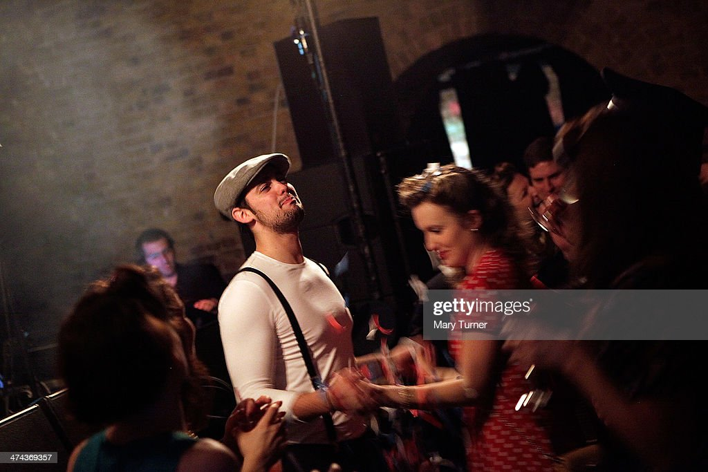 A couple in 1940s costumes dance to swing band 'The Red Roosters' during The Blitz Party on February 22, 2014 in London, England. Deep in an East End bunker hundreds of vintage enthusiasts partied like it was 1940 in a range of 1940's costumes. They danced to Swing and Jazz music from the era, drinking themed cocktails ordered at the Spitfire Bar, as they embraced the glamour of and popular nostalgia for the era.