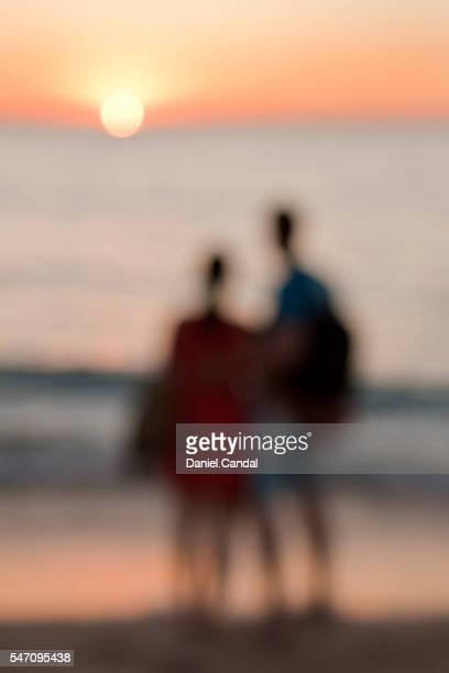 Couple in a beach at sunset