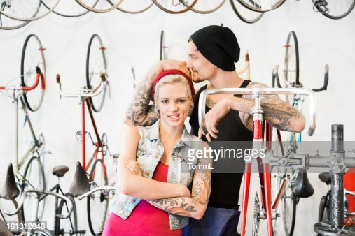 Couple in a Bike Store : Stock Photo