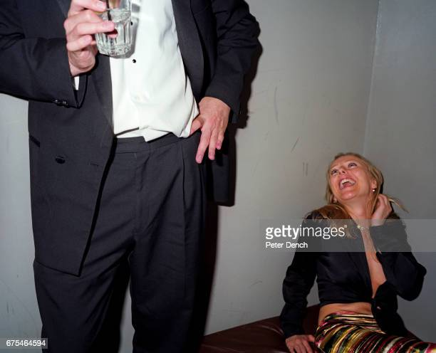 A couple in a booth of an exclusive basement club on the Kings Road in west London May 2000