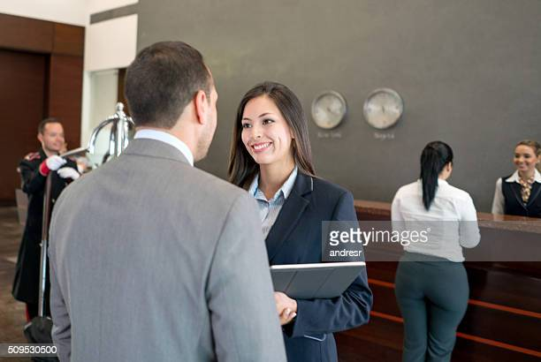 Couple in a business trip checking in a a hotel