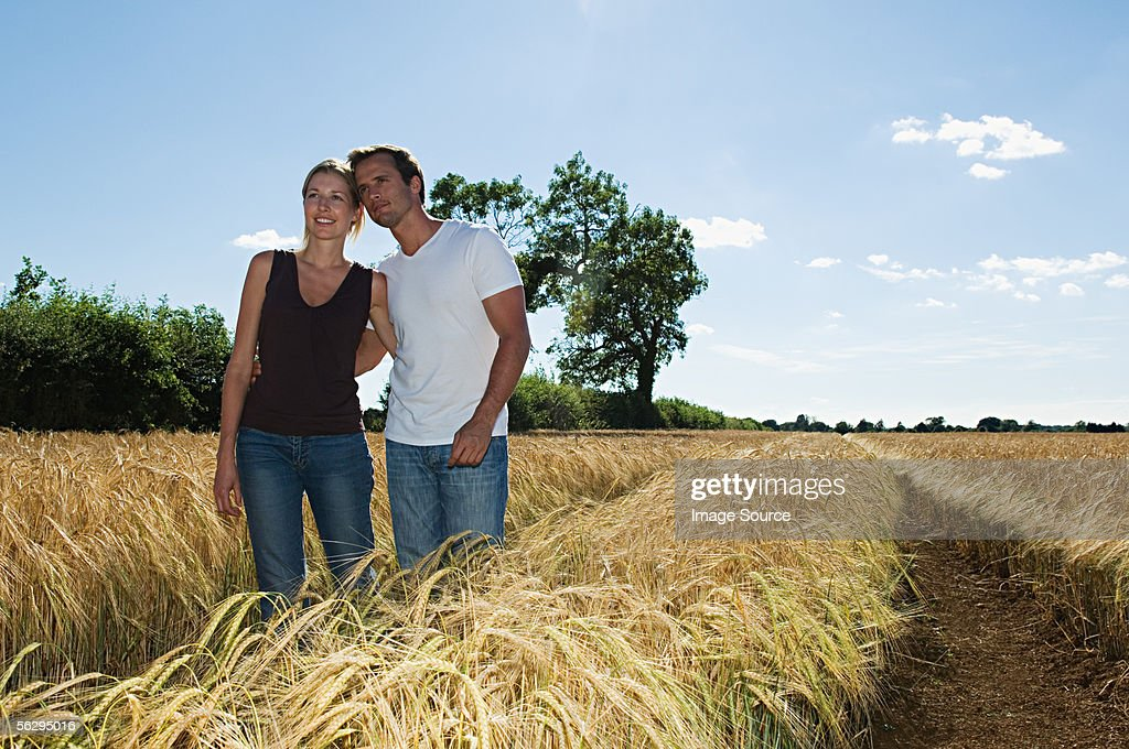 Couple in a field : Stock Photo