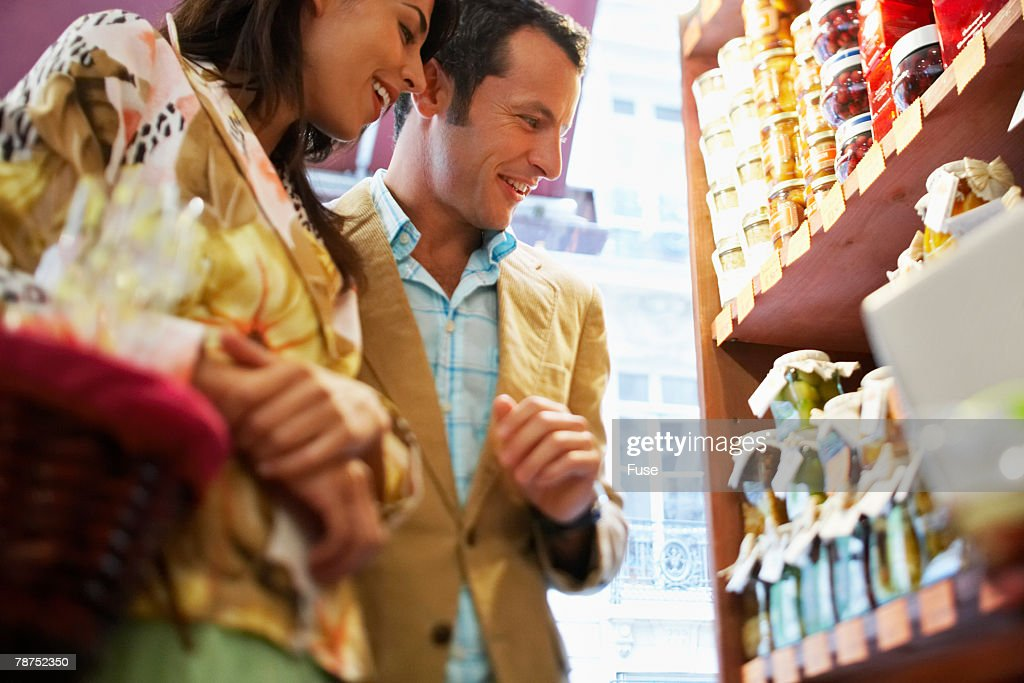 Couple in a Grocery Store : Stock Photo