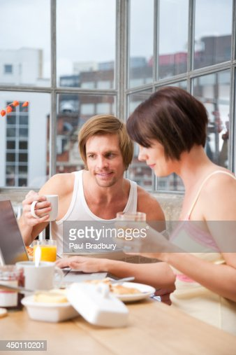Couple in a kitchen : Stock Photo