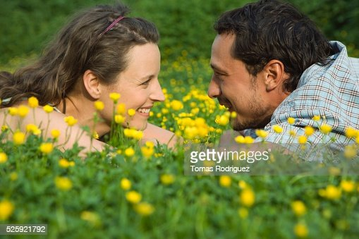 Couple in a Meadow : Bildbanksbilder