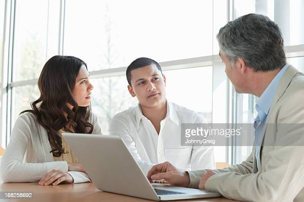 Couple In a Meeting With Financial Advisor