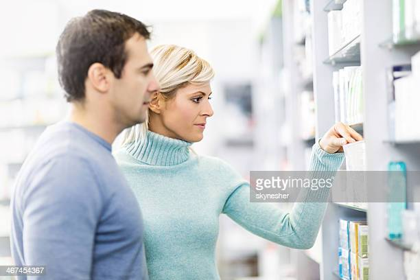 Couple in a pharmacy.