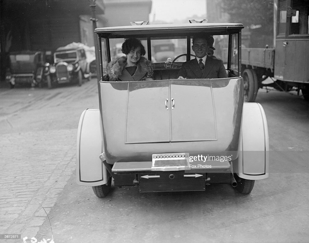 A couple in an observation car at the Motor Show The car can be entered from the back and there is an open view for the passengers who sit with their...