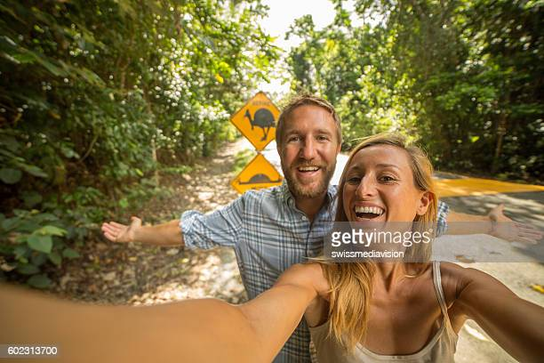 Couple in Australia take selfie with humorous cassowary road sign