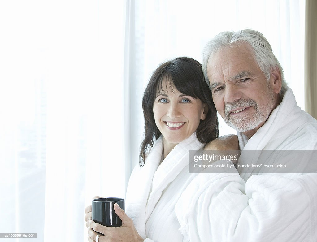 Couple in bathrobes, portrait