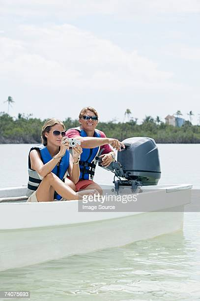 Couple in boat taking a picture