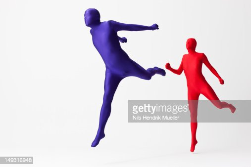 Couple in bodysuits jumping : Stock Photo