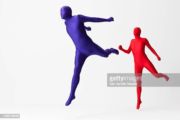 Couple in bodysuits jumping