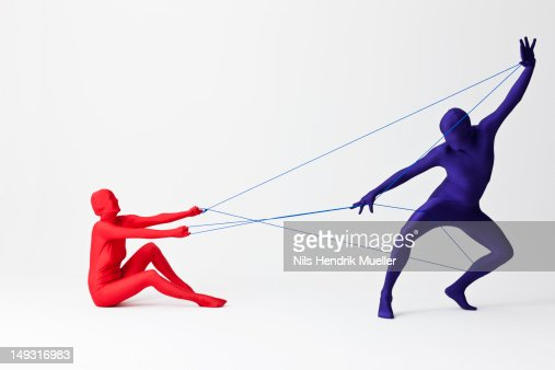 Couple in bodysuits playing with string : Stock Photo