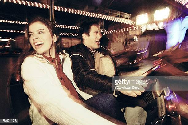 Couple in bumper car ride, close up (blurred motion)