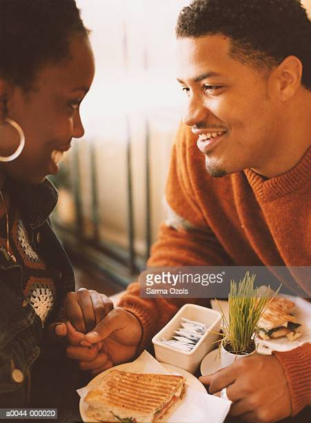 Couple in Cafe Talking