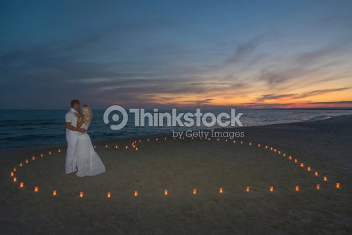 Couple In Candles Heart At Sea Beach Sunset Stock Photo