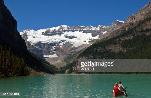 Couple In Canoe Lake Louise Banff